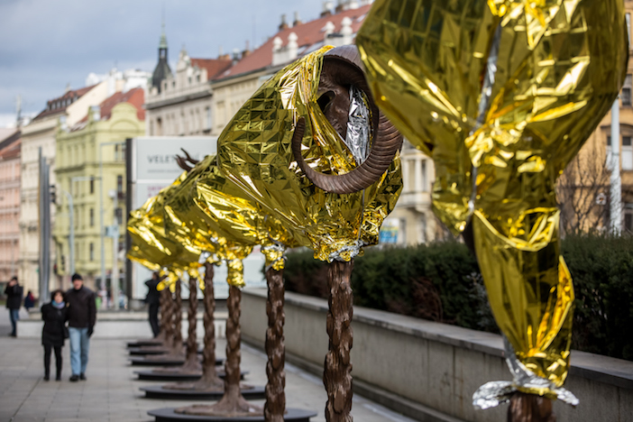 Circle of Animals / Zodiac Heads sculptures by Chinese artist Ai Weiwei. He wrapped his bronze heads with thermal blankets to protest against migrants situation in Europe.